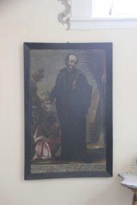 Pfarrer tauft Schwarze Kloster Wald